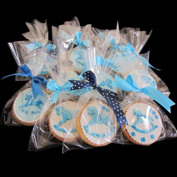 Biscotti in confezione regalo per un Battesimo a tema cavallo a dondolo