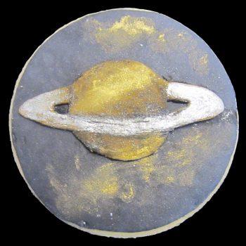 Biscotto del pianeta Saturno decorato in pasta di zucchero