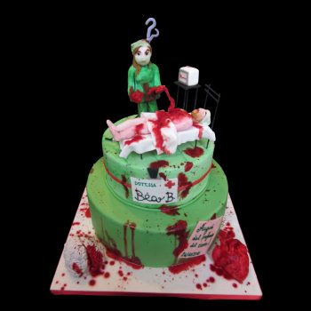 Torta decorata in pasta di zucchero per una laurea a tema chirurgia splatter