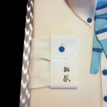 Iniziali del festeggiato dipinte nella manica della camicia