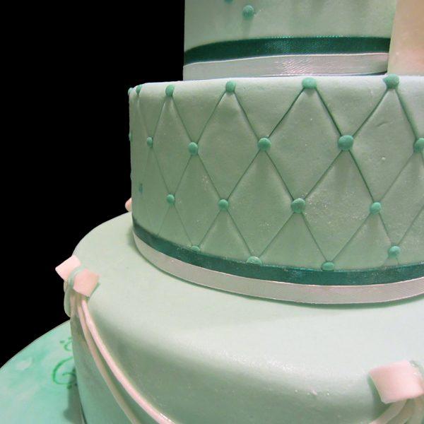 Motivo decorativo a rombi in pasta di zucchero