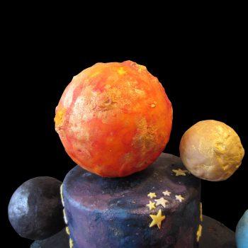Sole, Luna e Plutone in pasta di zucchero