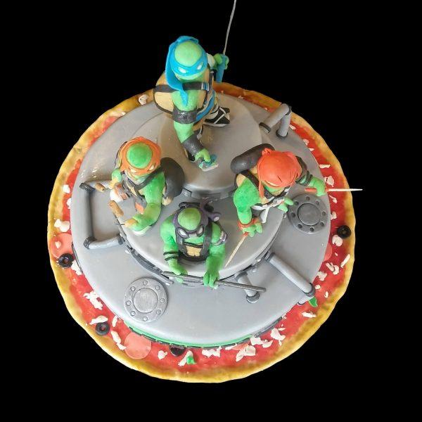 Torta decorata in pasta di zucchero per un compleanno a tema Tartarughe Ninja