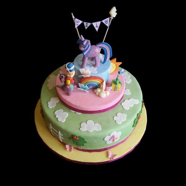 Torta decorata in pasta di zucchero per un compleanno a tema Miny Pony
