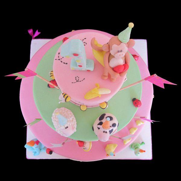 Torta decorata con animaletti in pasta di zucchero per un compleanno