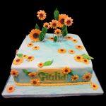 Torta decorata con girasoli in pasta di zucchero per un compleanno
