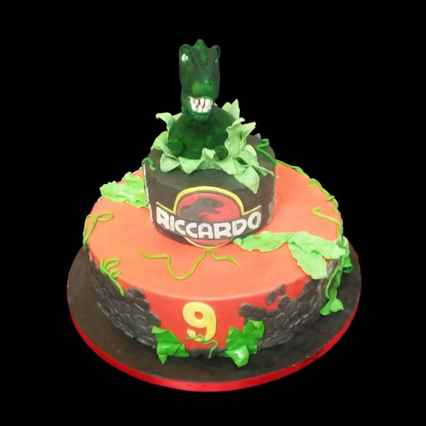 Torta decorata in pasta di zucchero per un compleanno a tema Jurassic Park